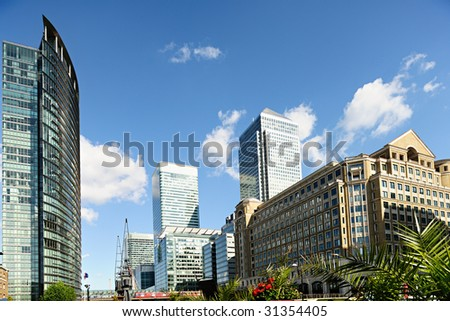 Canary Wharf London England UK from West India Quay on a sunny afternoon - stock photo