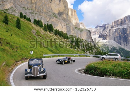 Canazei (TN) ITALY - AUGUST 30: Giuliano Can���¨ takes part and wins the Coppa d'Oro delle Dolomiti historic car race with his Lancia Aprilia, on August 30, 2013 in Canazei (TN) - stock photo