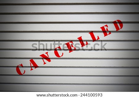 Cancelled message on gray wall. Business Concept. - stock photo
