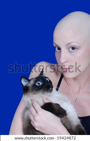 """Cancer patient with her cat in front of blue background says """"never give up"""", special DOF - stock photo"""