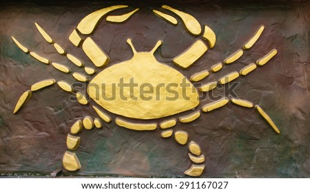 Cancer sign of horoscope on the wall - stock photo
