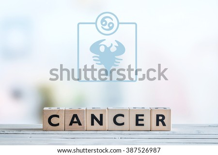 Cancer star sign on a wooden table - stock photo