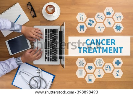CANCER TREATMENT Professional doctor use computer and medical equipment all around, desktop top view, coffee - stock photo
