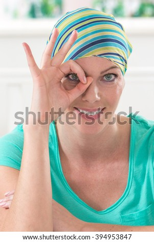 Cancer woman with hand OK sign isolated   - stock photo