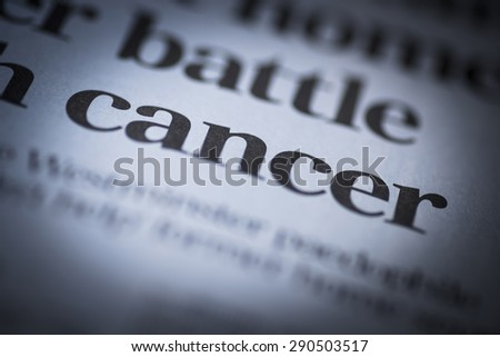 Cancer written newspaper, shallow dof, real newspaper. - stock photo