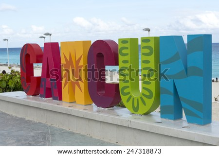 CANCUN - JANUARY 18: CANCUN inscription in front of the Playa Delfines beach on 18 January 2015 in Cancun, Mexico. This is one of the best beaches in the Mexico. - stock photo