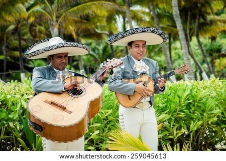 CANCUN, MEXICO â?? SEPTEMBER 1: Mariachi band play Mexican music on 1 of September 2014 at a wedding in Cancun Mexico. - stock photo