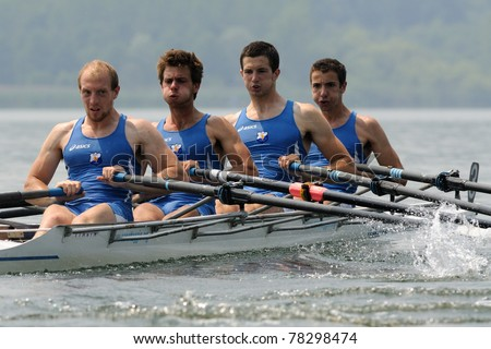 CANDIA, TURIN, ITALY - MAY 22: the CUS Torino quad (quadruple) scull (4x) crew rowing during 2011 Rowing CNU University National Championship on May 22, 2011 on Candia lake, Turin, Italy - stock photo
