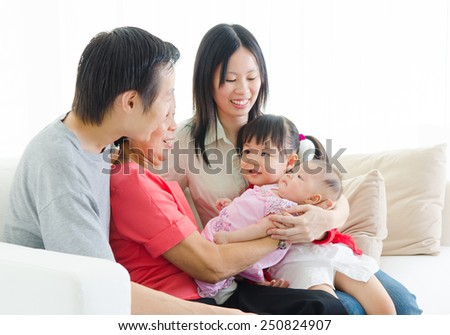 Candid lifestyle of asian three generations family. - stock photo