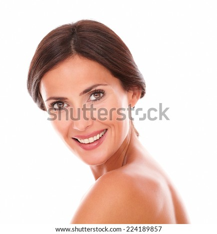 Candid portrait of sexy and beautiful woman smiling at camera with nude shoulders on isolated studio - stock photo