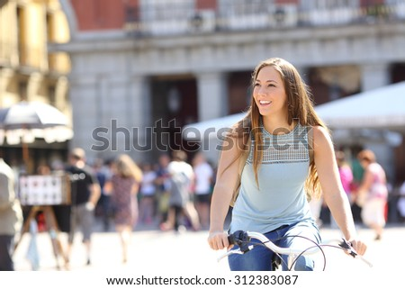 Candid tourist cyclist sightseeing in a old town of a city - stock photo