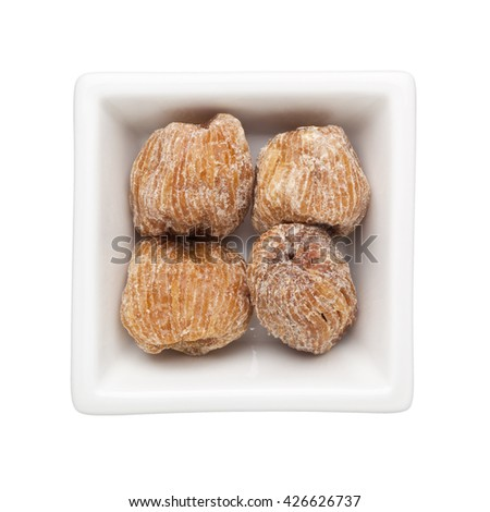 Candied jujubes in a square bowl isolated on white background - stock photo