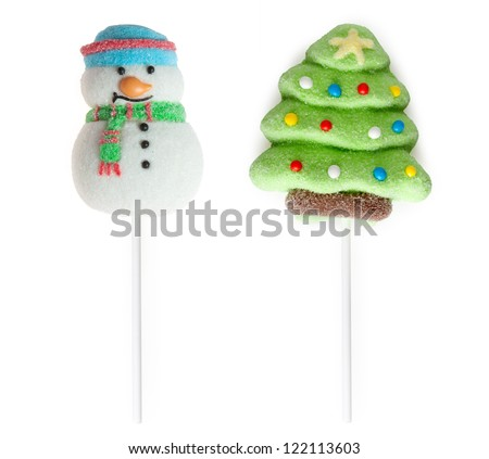 Candies: fir-tree and snowman on sticks on a white background - stock photo