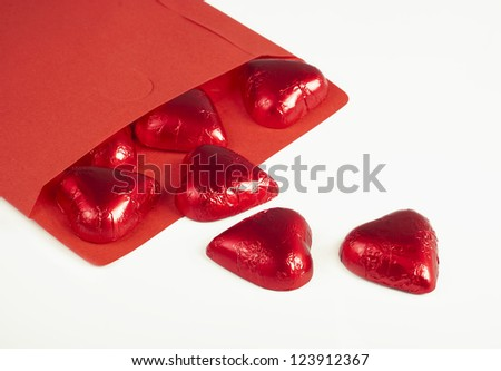 candies hearts got enough sleep from a paper envelope isolated on white - stock photo