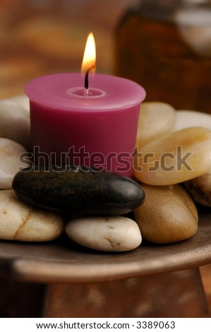 Candle and River Stones - stock photo