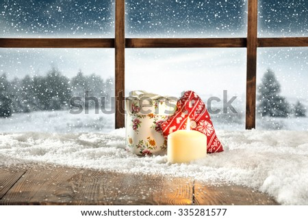 candle and snow and window winter desk  - stock photo