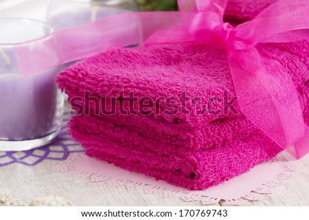 Candle and towels in health spa for spa treatment. - stock photo