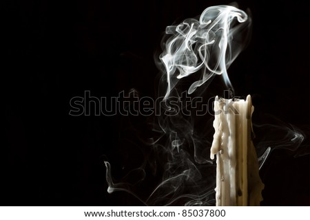 Candle blow off with smoke - stock photo
