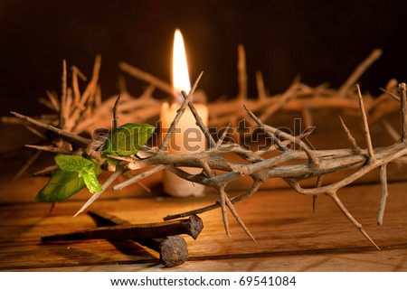 Candle burning in a crown of thorns at Easter - stock photo