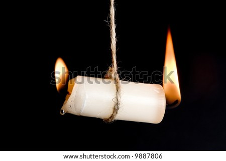 Candle burning on two sides, as a metaphor for burn-out - stock photo