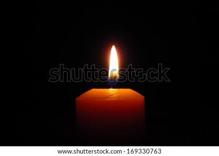 Candle close up, black background                                - stock photo
