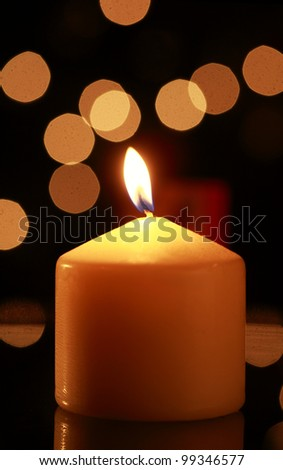 Candle flame against abstract background - stock photo