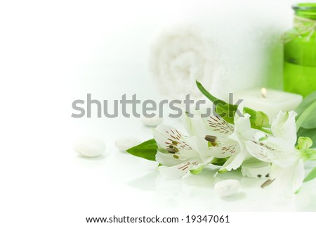 Candle, flowers and towel (SPA concept) - stock photo