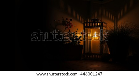candle in lantern by night with copy space - stock photo