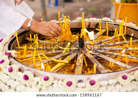 Candle in the hands for worship Buddha. - stock photo