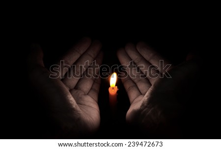 Candle light in hand, Hope and pray concept - stock photo