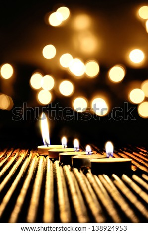 Candle light with light bokeh in the background - stock photo
