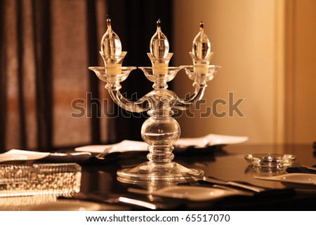 Candle lights on the table in the restaurant - stock photo
