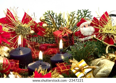 Candle lit Christmas holiday centerpiece. With Main focus on candles - stock photo