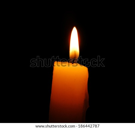candle over black background - stock photo
