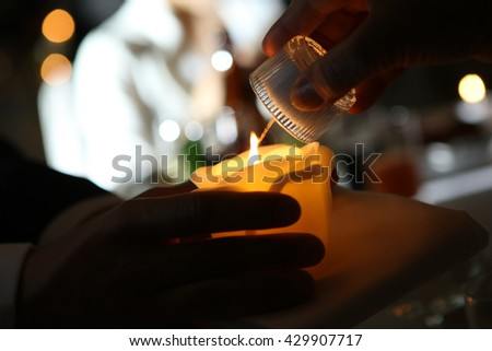 Candle relay?candlelight - stock photo