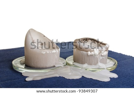 Candle wax stains on fabric over white background - stock photo