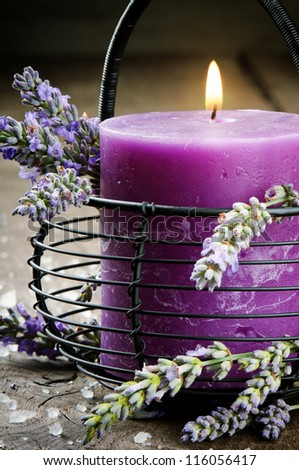 Candle with lavender flowers. Aromatherapy concept - stock photo