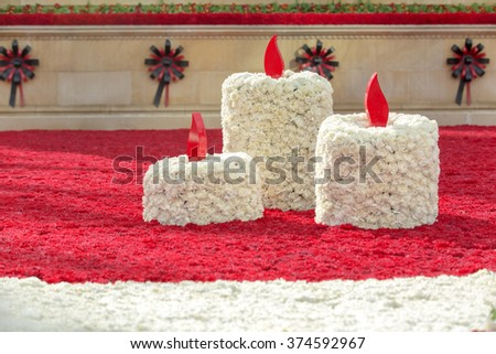candles and carnations flowers symbol of mourning. - stock photo
