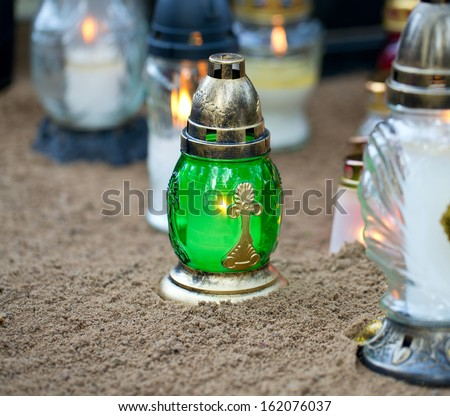 candles and flowers at cemetery - stock photo
