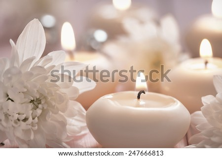 Candles and flowers on a wooden table - stock photo