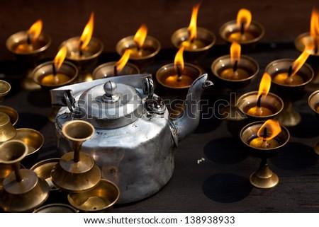 Candles and pot at Boudhanath stupa in Kathmandu, Nepal - stock photo