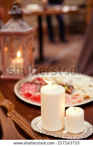 candles and yummy italian food - stock photo