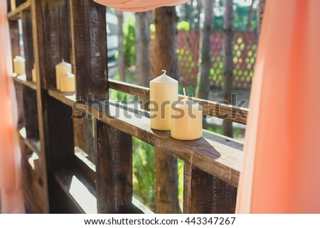 Candles as a decoration on the wedding dinner - stock photo