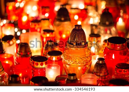 Candles Burning At a Cemetery. Shallow depth of field. - stock photo