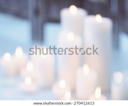 Candles flame at night with bokeh. Abstract blurred background - stock photo