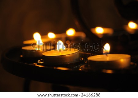 Candles in church in a range - stock photo
