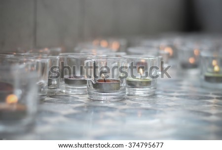 Candles in glass.Light a candle in a glass. - stock photo