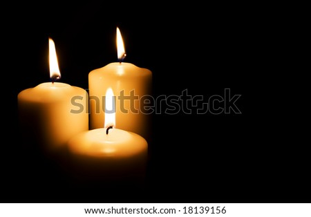 Candles isolated on black background - stock photo