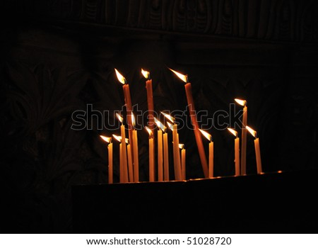 Candles on Calvary, Church of the Holy Sepulcher - stock photo