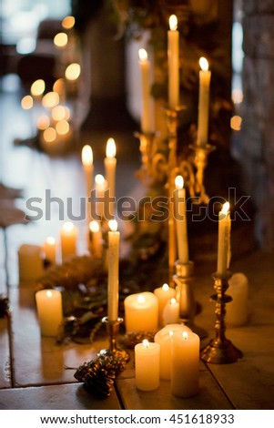 candles on golden candlestick and branches of spruce - stock photo